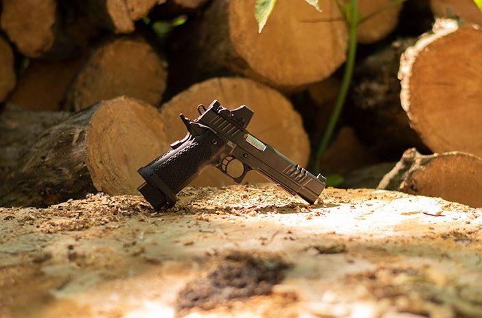 Staccato handgun pistol on tree trunk