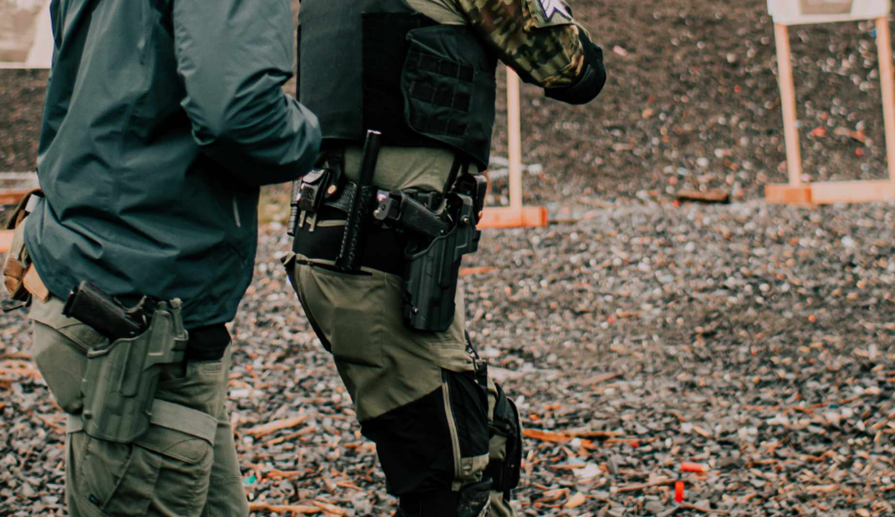 Individual with instructor firing Staccato handgun on the range