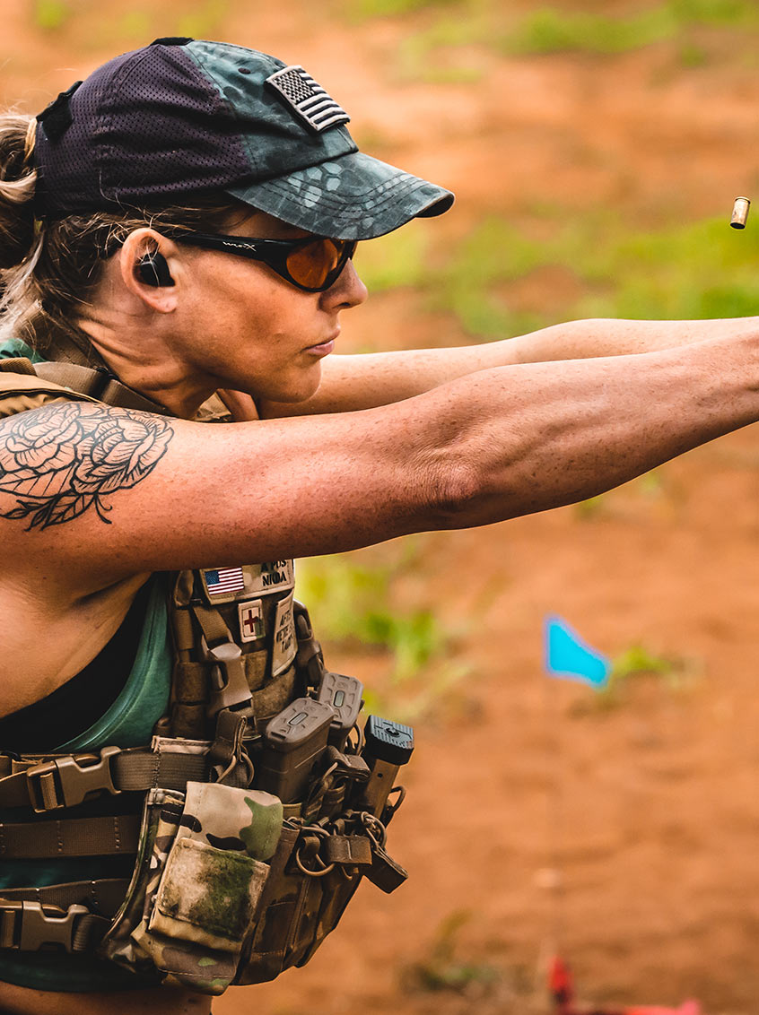 Woman with Staccato handgun firing on the range