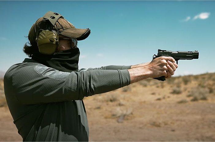 Man holding Staccato handgun pistol