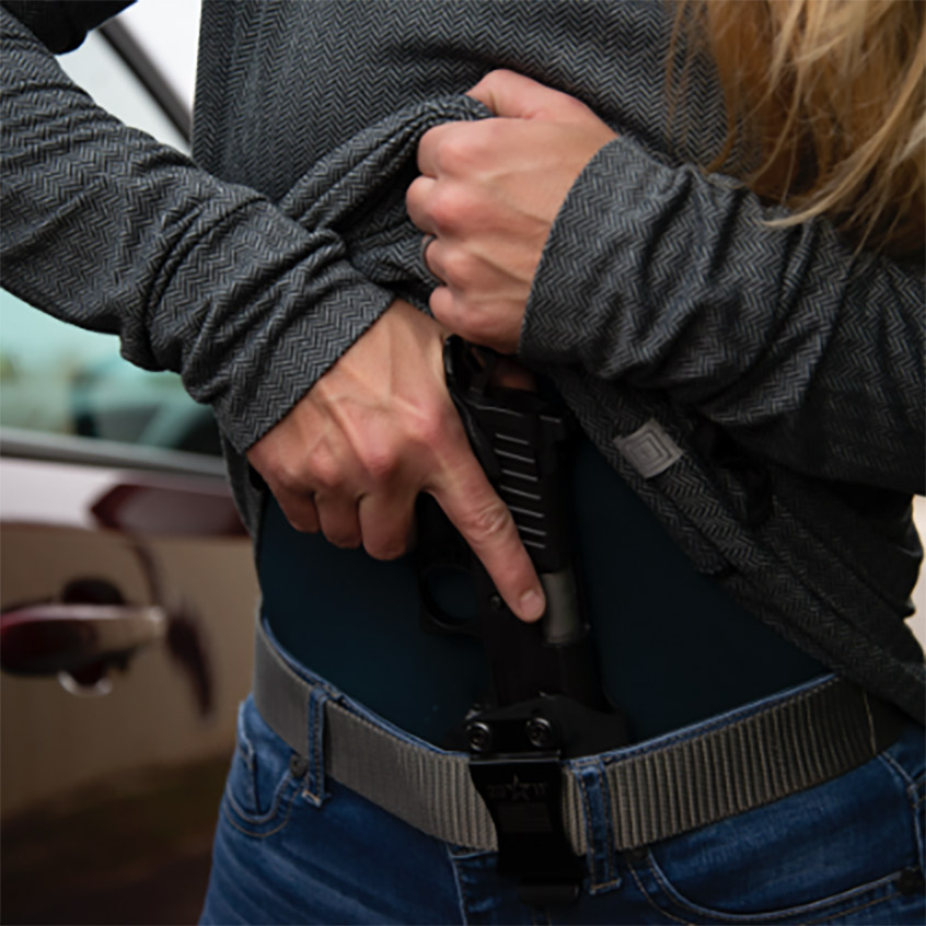 Women pulling out concealed carry Staccato handgun