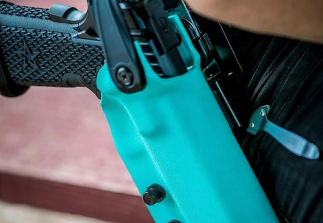 Staccato handgun in a light blue holster