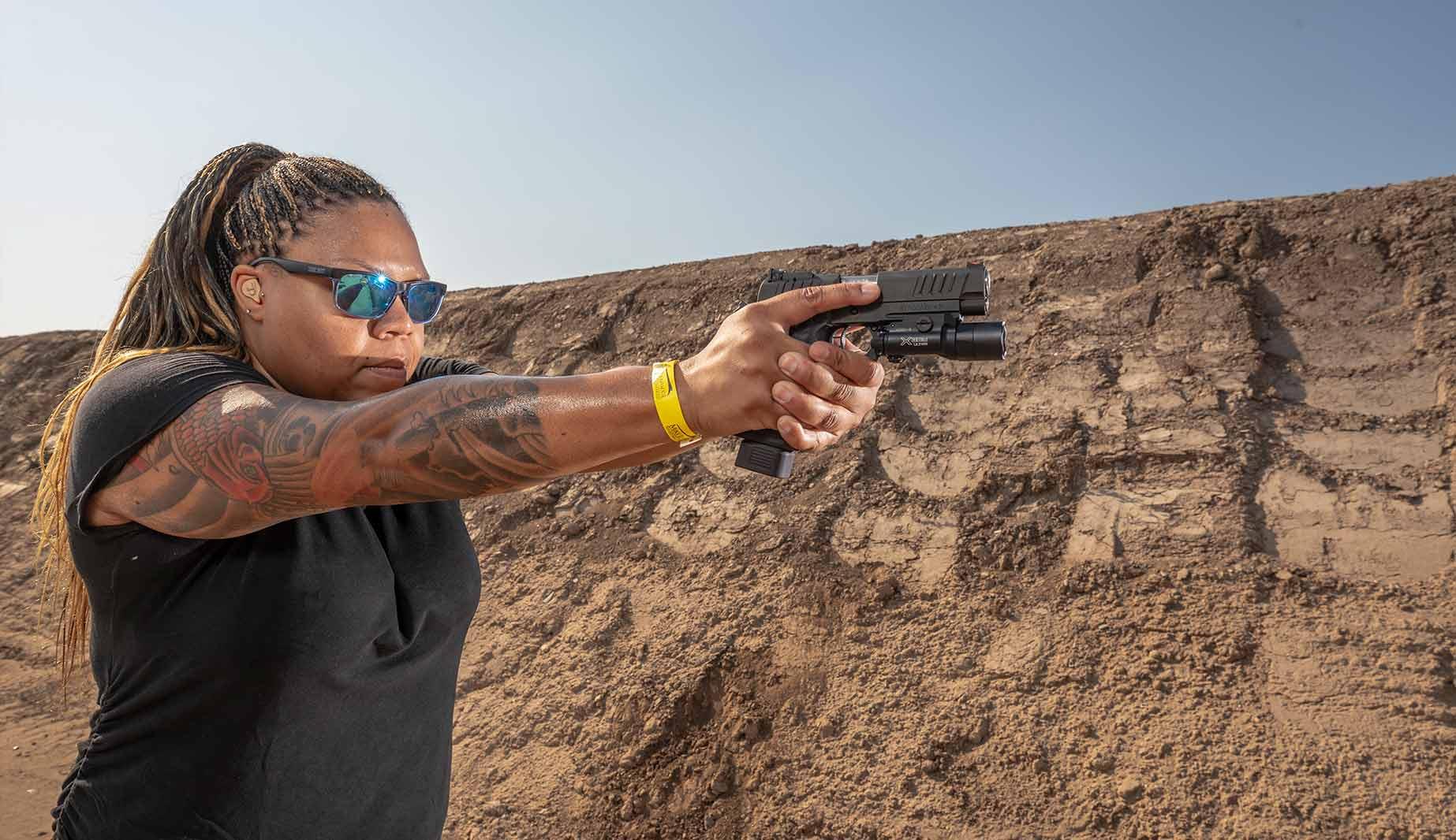 Women aiming Staccato handgun
