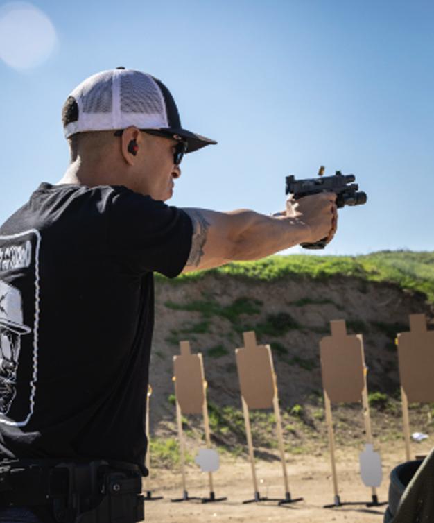 Man firing Staccato handgun at the range