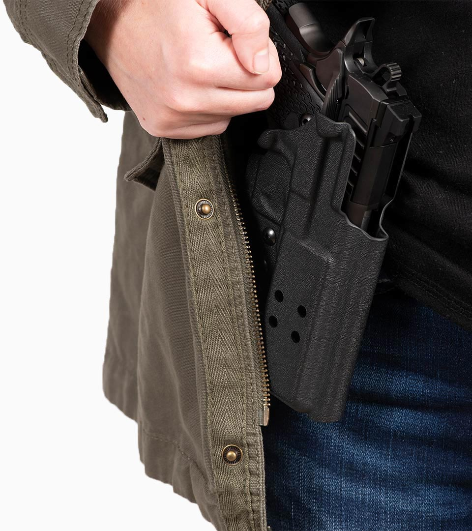Concealed carry Staccato handgun under individuals jacket