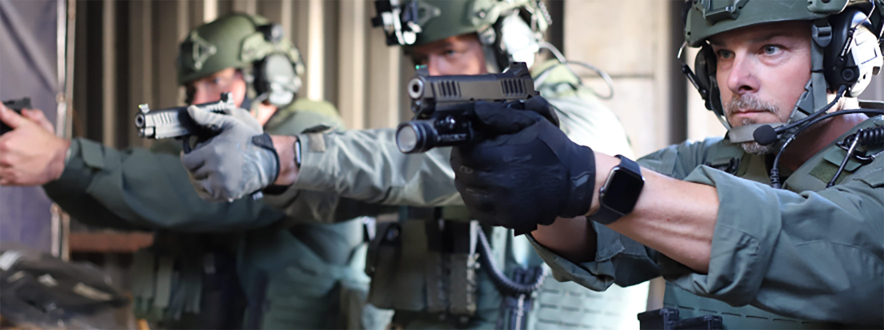 Three men in tactical gear aiming Staccato handguns