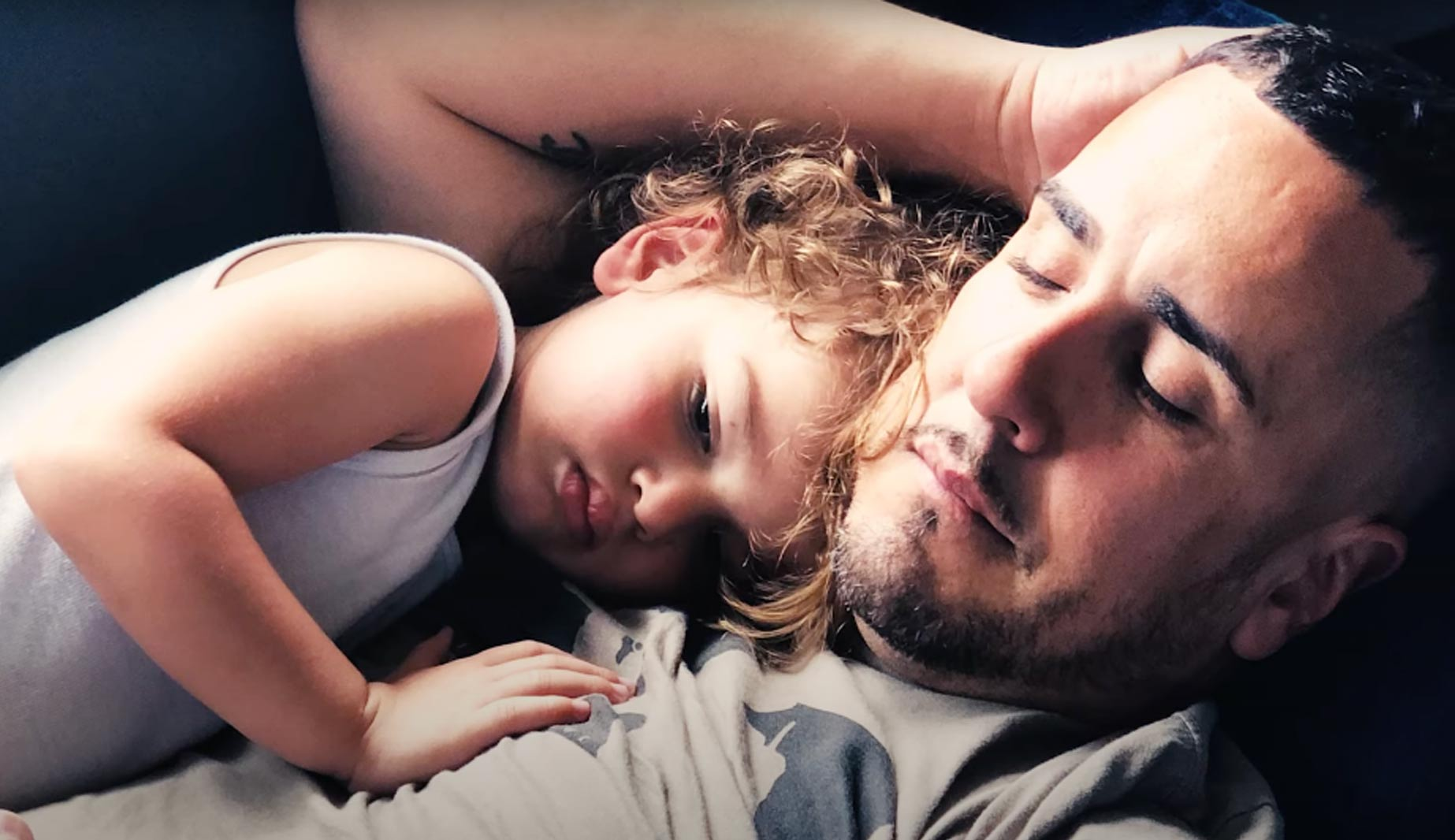Father with daughter resting her head on him