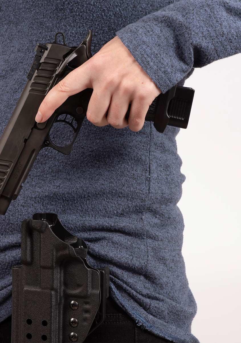 Individual drawing a Staccato handgun