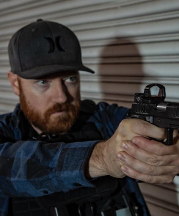 Man aiming Staccato handgun