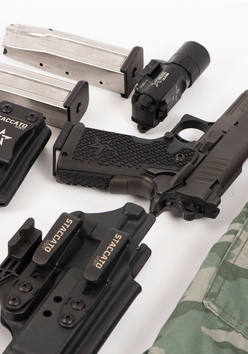Staccato handgun and accessories displayed on a table