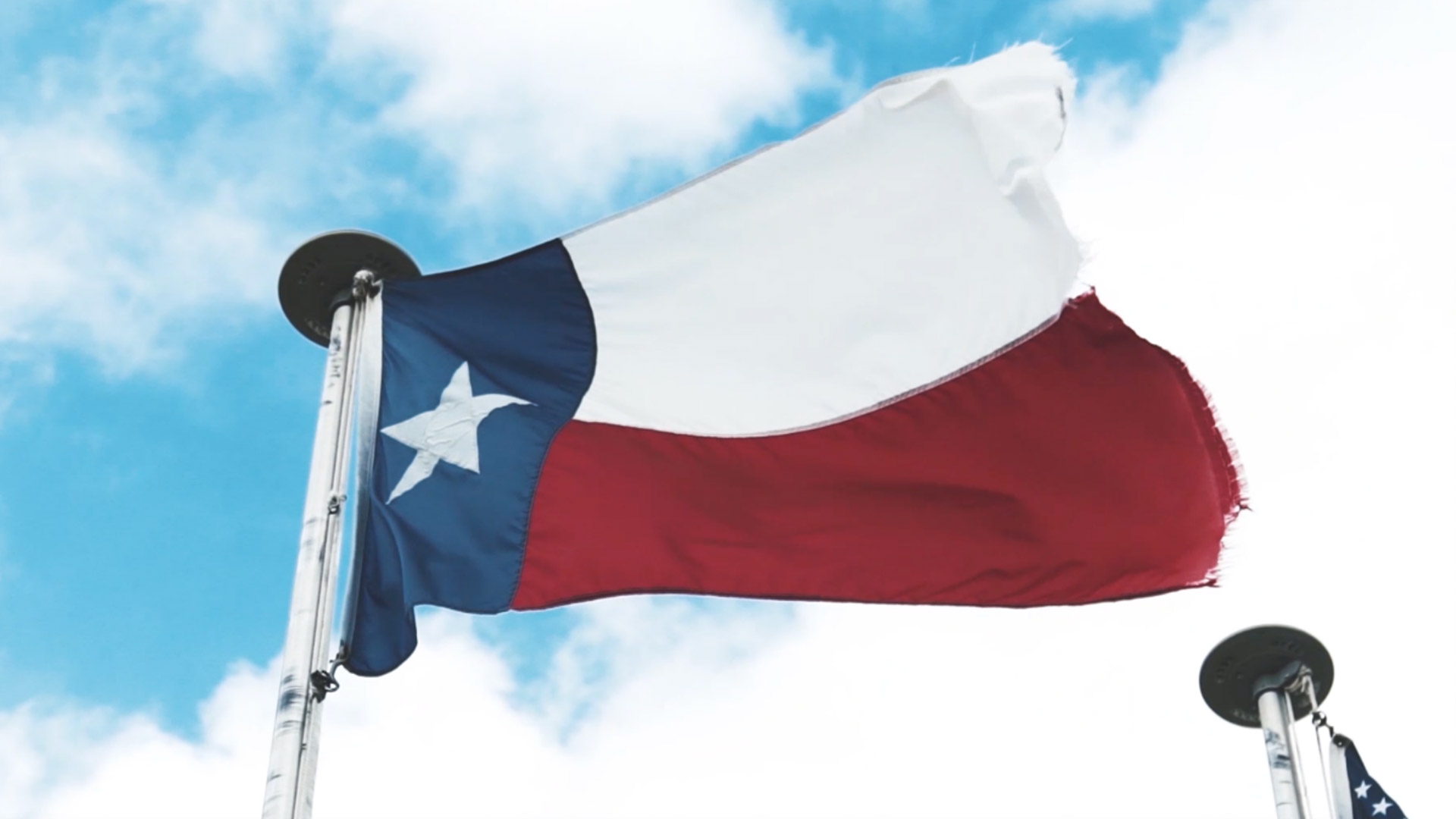 Texas flag swaying in the breeze