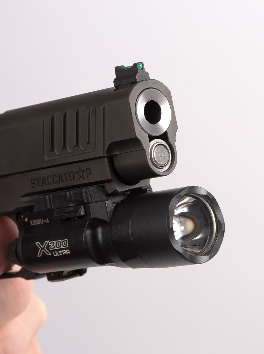 Staccato P handgun muzzle with attached flashlight