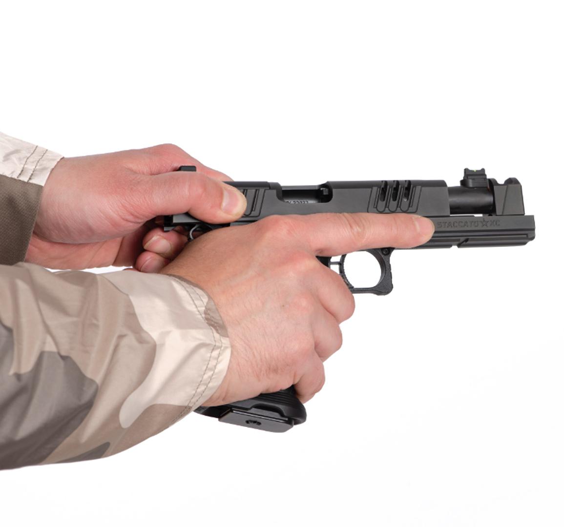 Individual loading a Staccato XC handgun