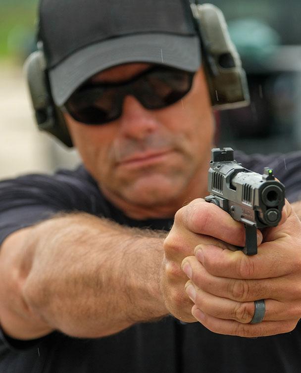 Bob Keller shooting Staccato handgun on the range