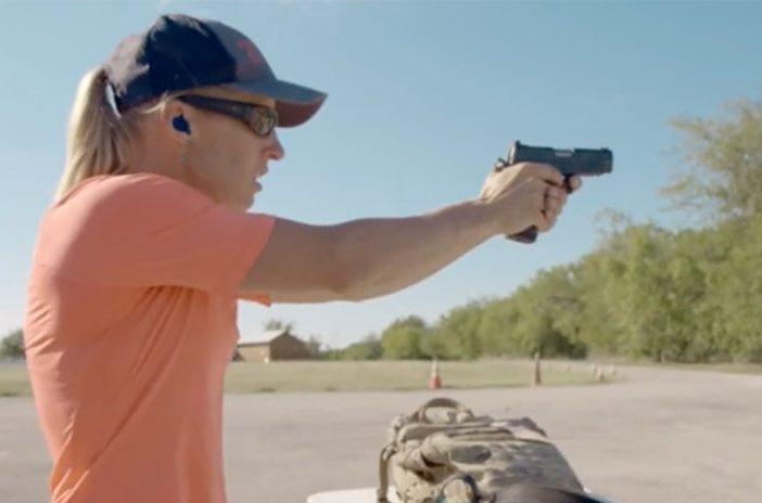 Woman holding Staccato handgun pistol
