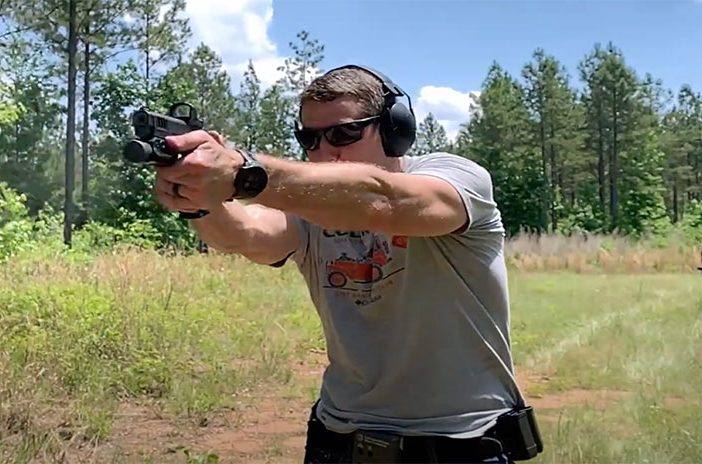 Man shooting handgun pistol