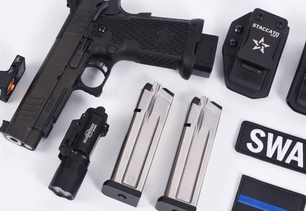 Staccato P handgun and accessories displayed on a table