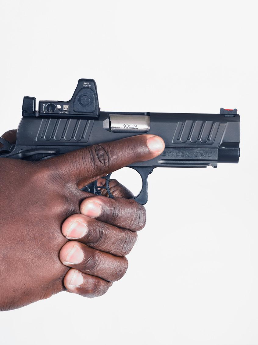 Man aiming Staccato C handgun