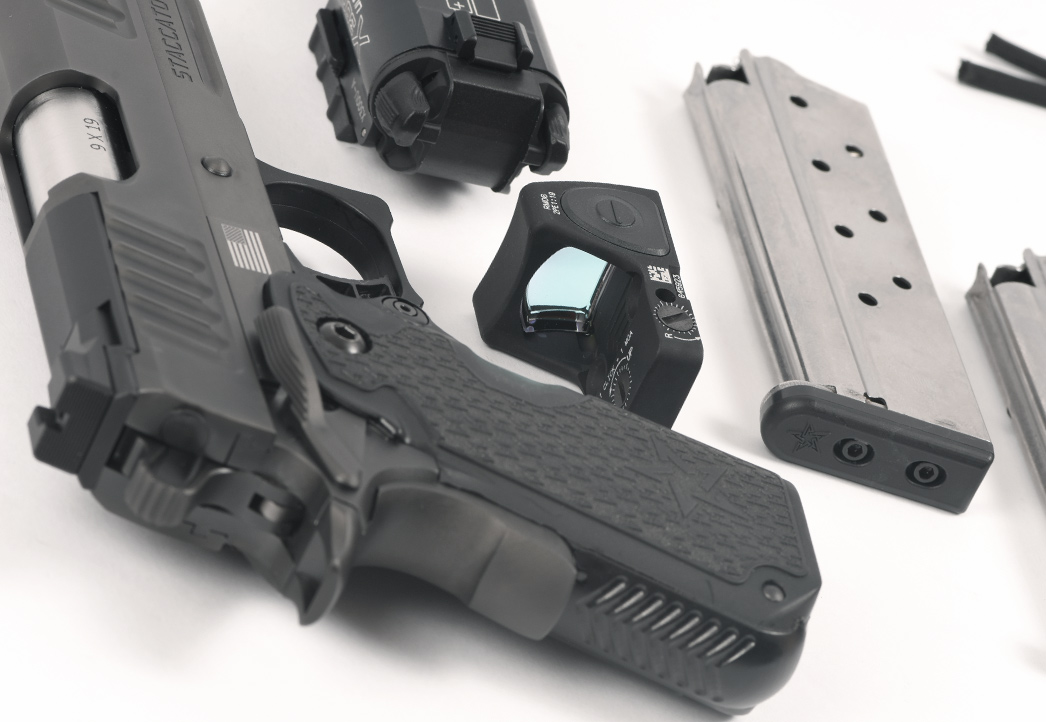 Staccato C handgun and accessories on table