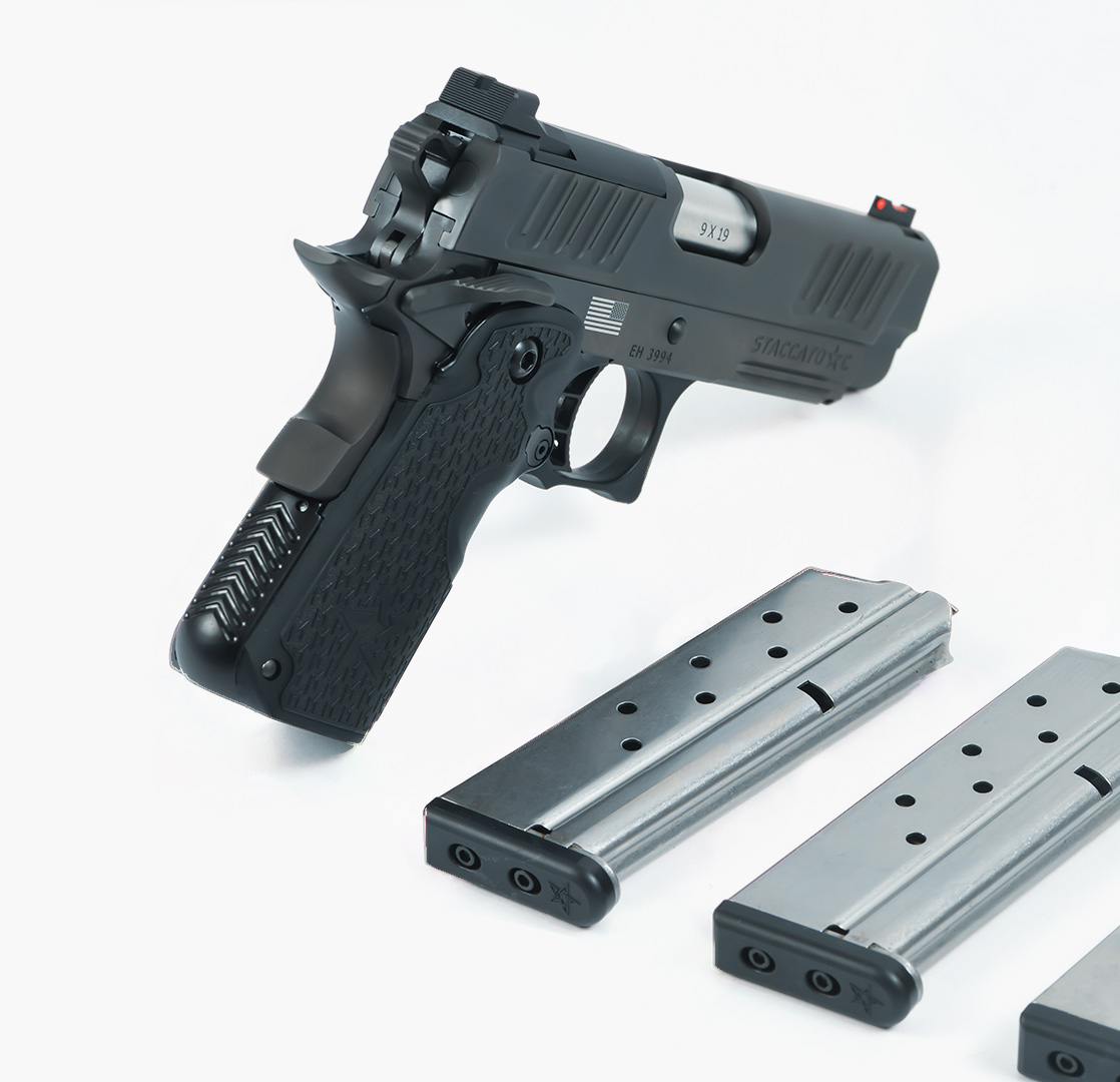 Staccato C handgun with 3 magazines next to it