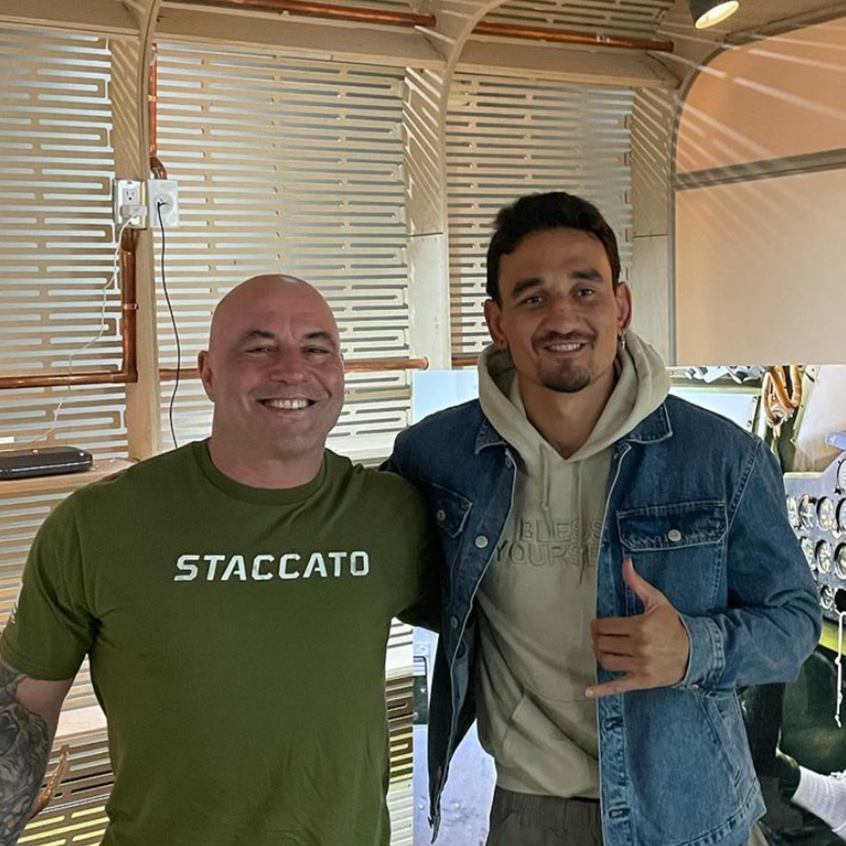 @JoeRogan posing for photo with another individual