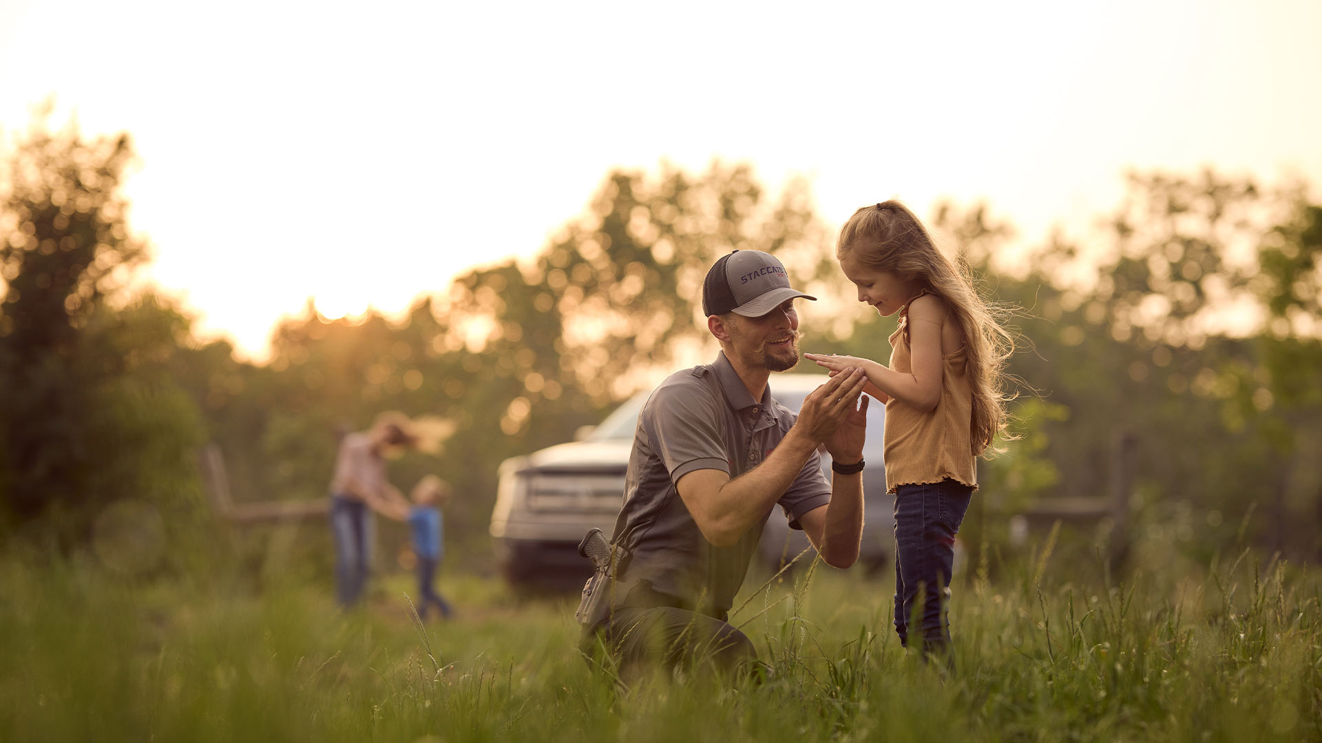 Father, with holstered Staccato handgun, smiling at his daughter