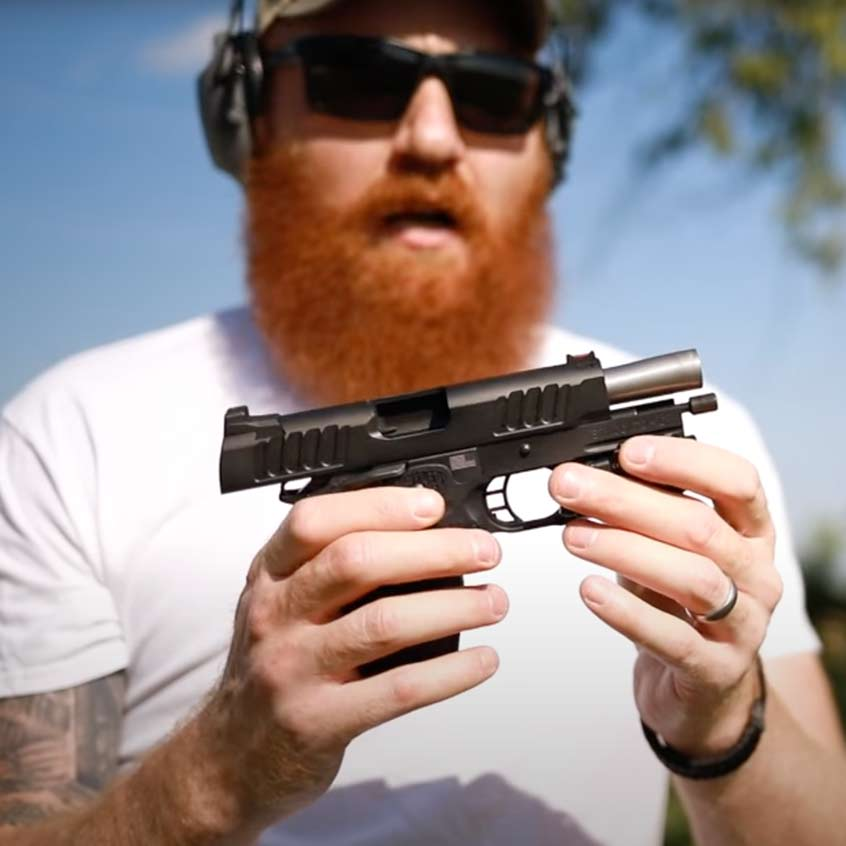 @Honest Outlaw loading a Staccato handgun at the range