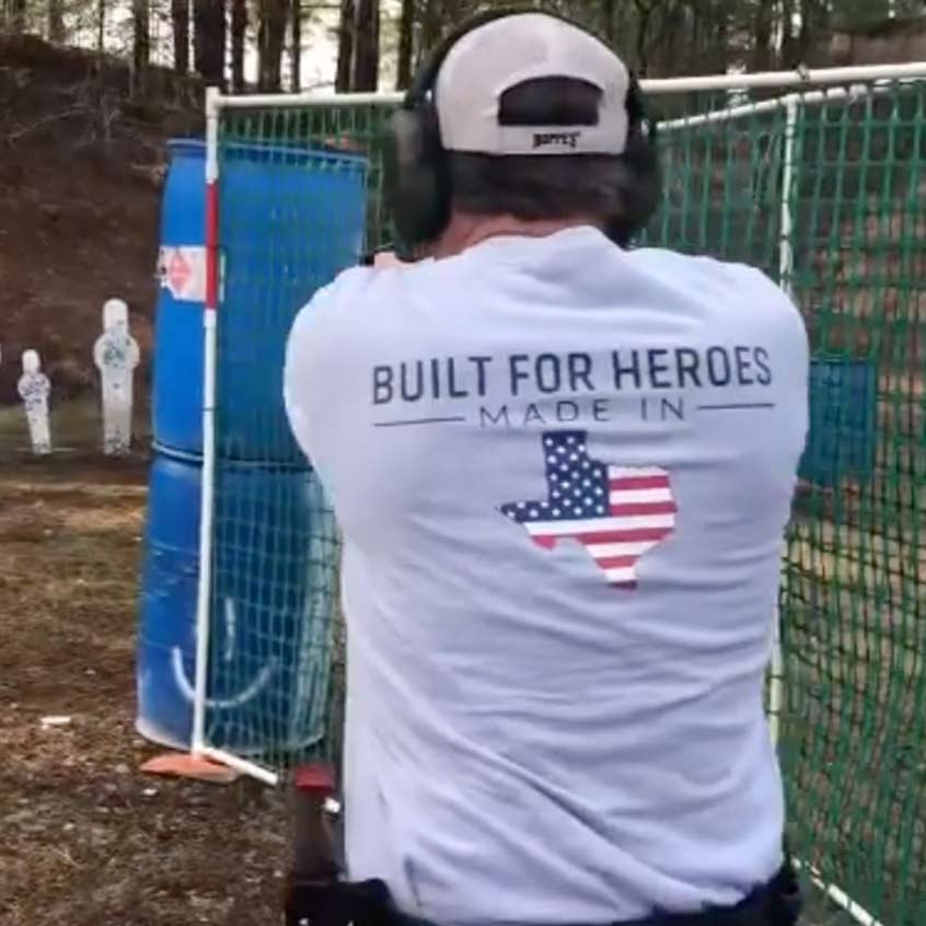 Man wearing a Staccato t-shirt firing a Staccato handgun on the range
