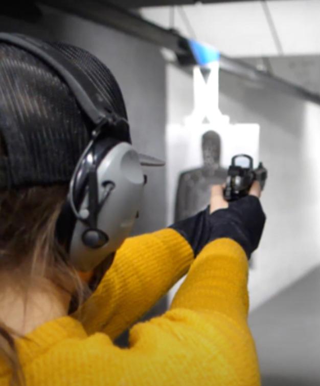 New shooter aiming Staccato handgun down range