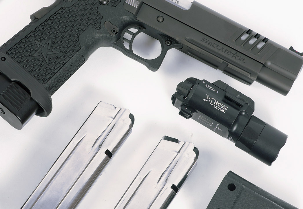 Staccato XL handgun and accessories displayed on table