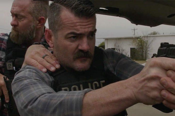 Police officers holding Staccato handgun pistol