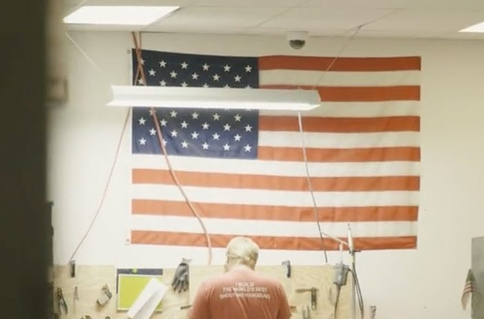 Man standing in front of American Flag