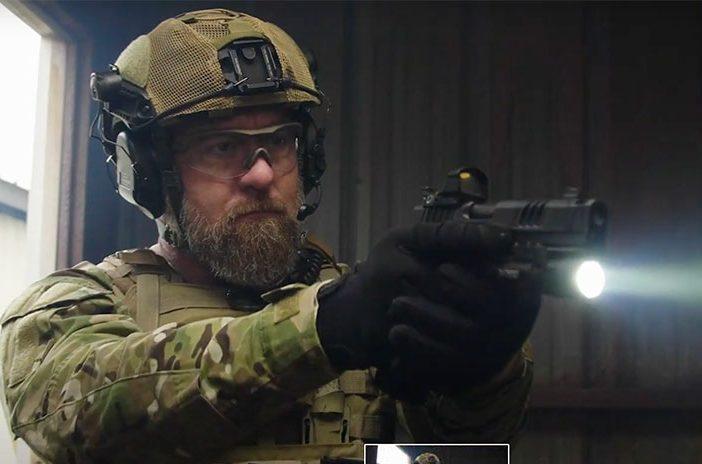 Solider holding Staccato handgun pistol