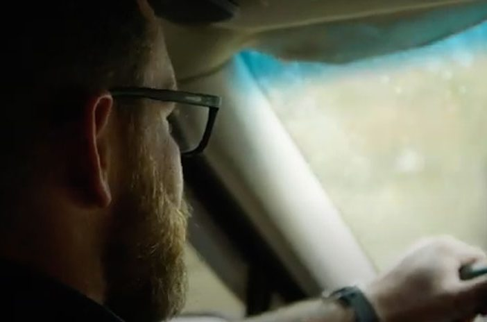 Man driving car in rain
