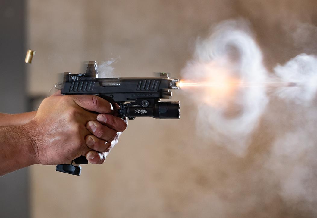 Man drawing Staccato C2 handgun