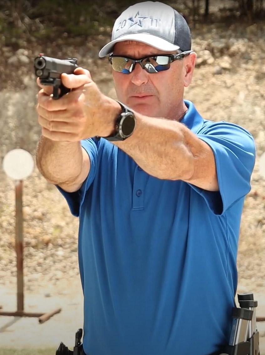 Man firing a Staccato handgun