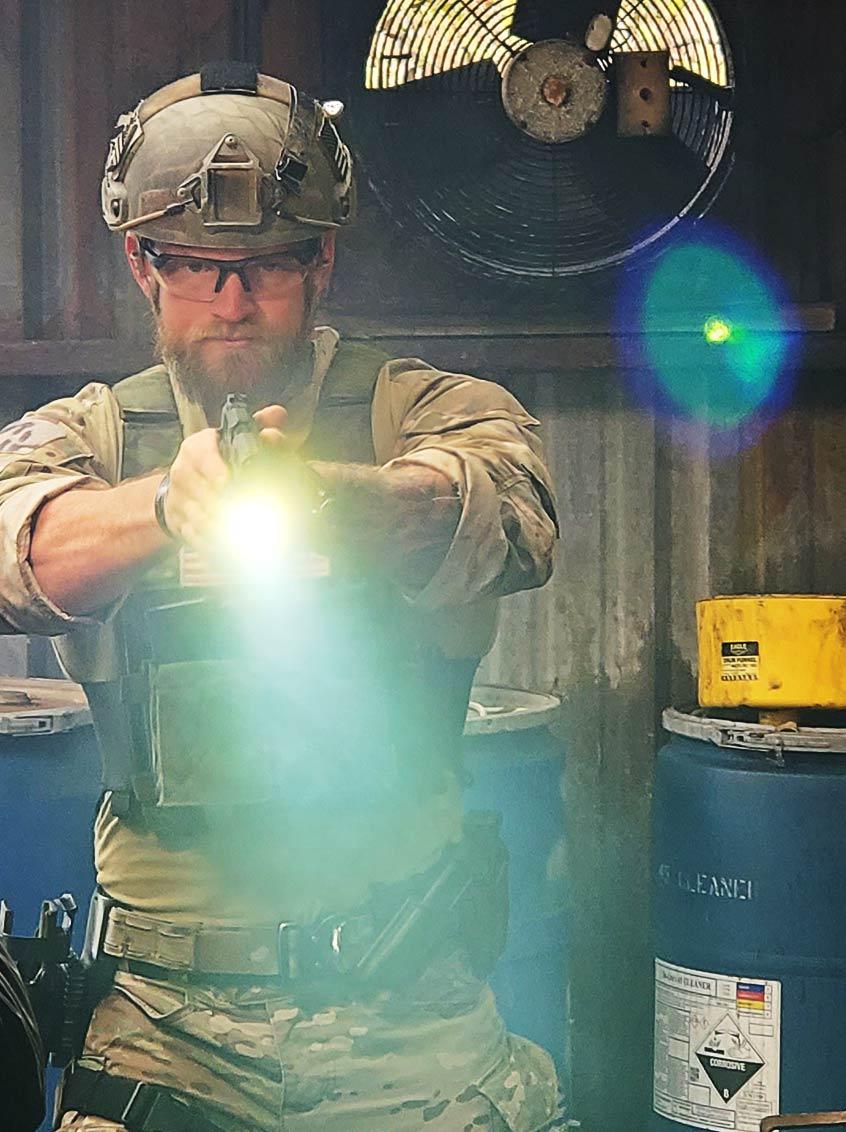 Soldier holding Staccato handgun