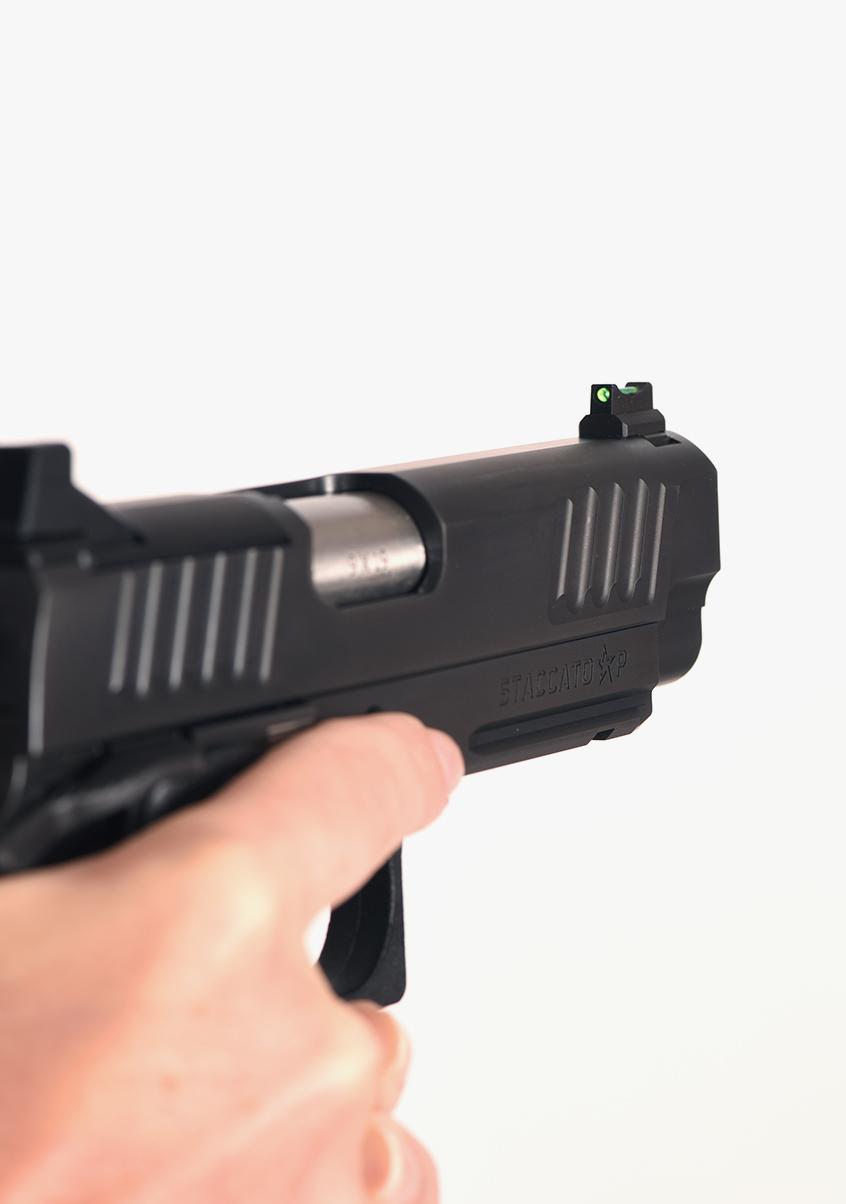 Hand gripping Staccato P handgun
