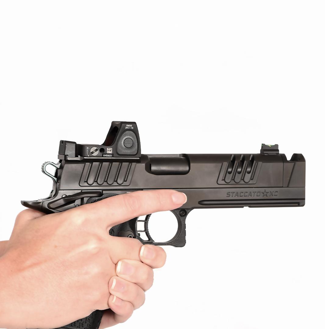 Hands gripping a Staccato XC handgun